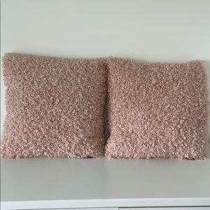 2 UGG pillows
